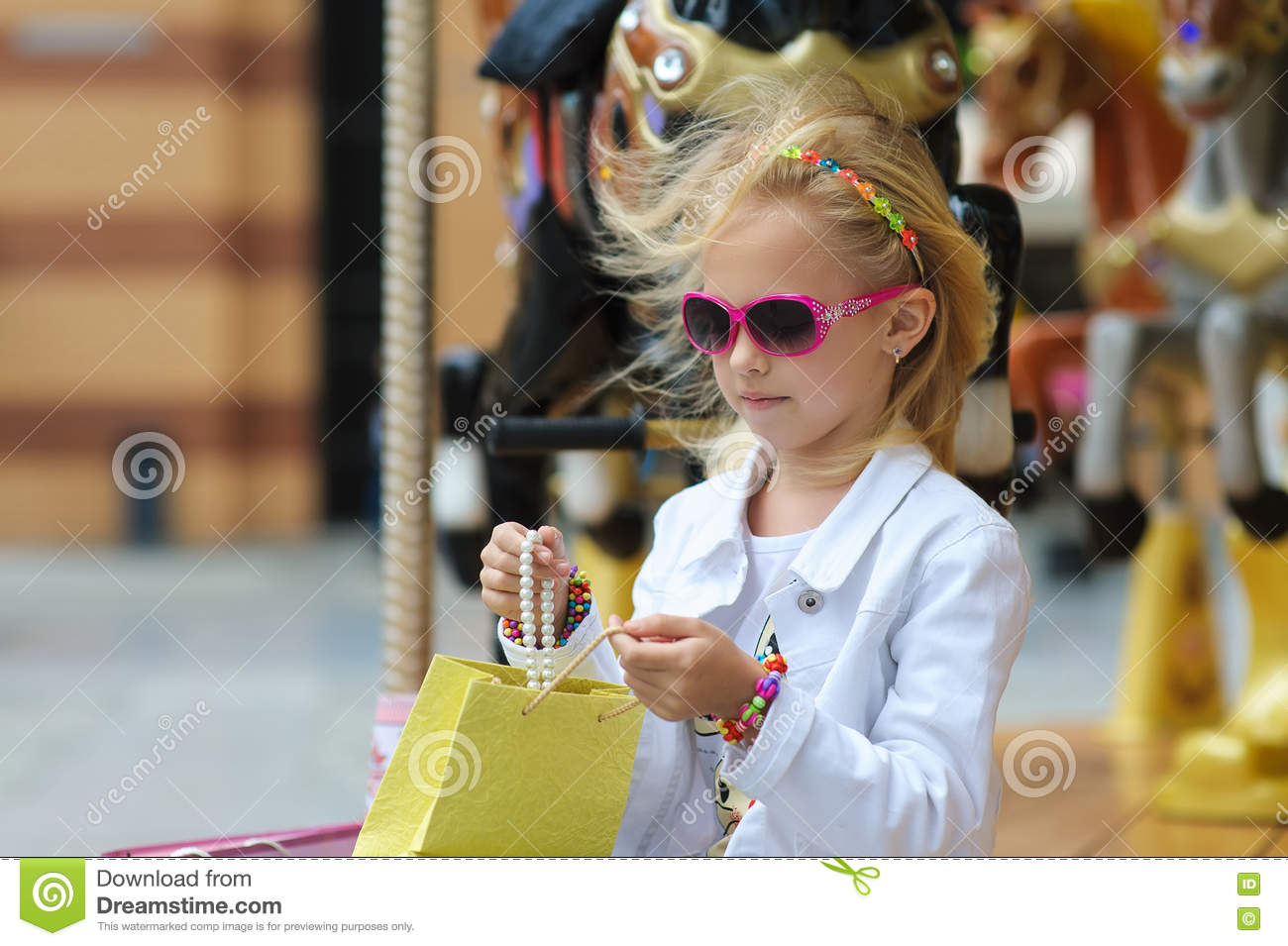 f0f262eb2 Child On Carousel With Full Shopping Bags. Stock Photo - Image of ...