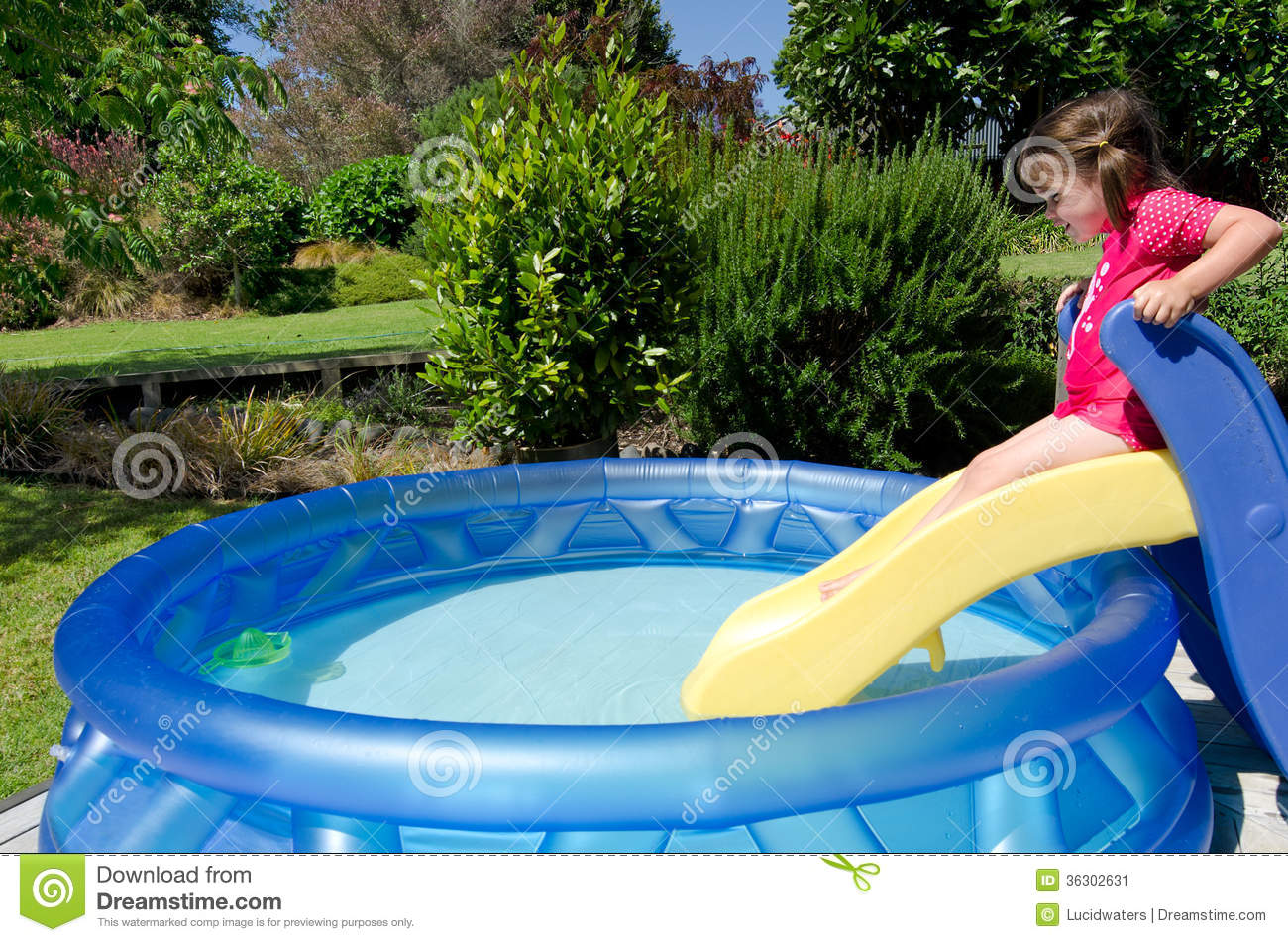 Child in children inflatable pool stock image image for Kids swimming pool garden