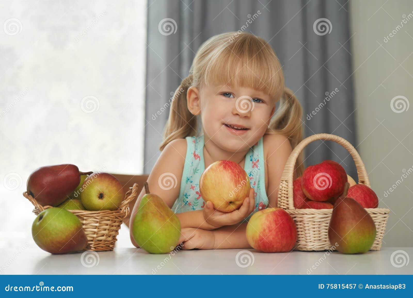 Child choosing a fresh apple to eat