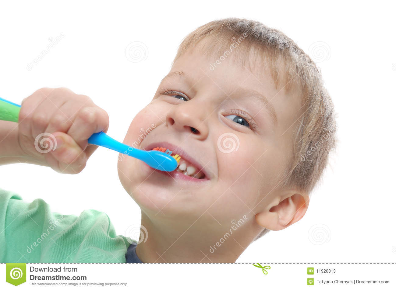 Little boy cleaning his teeth over white background.