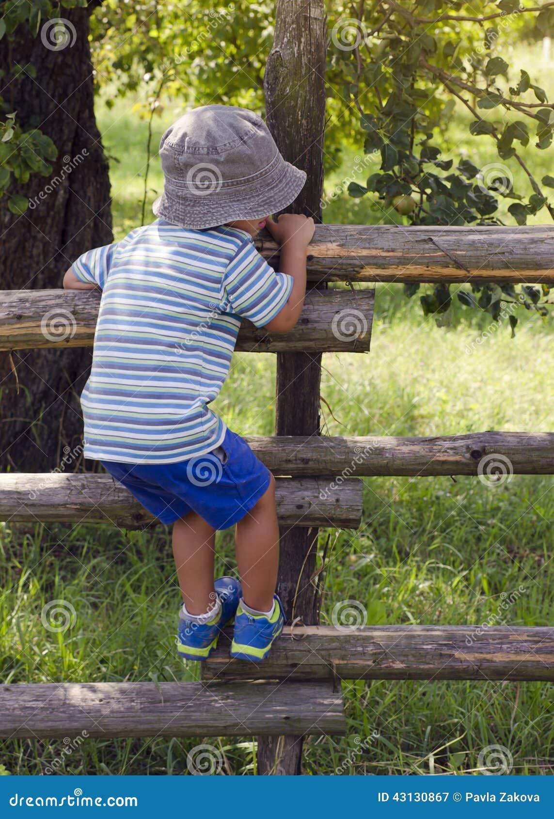 Child climbing the fence