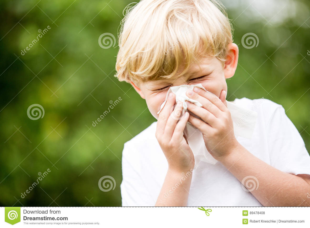 Child with a cold sneezing