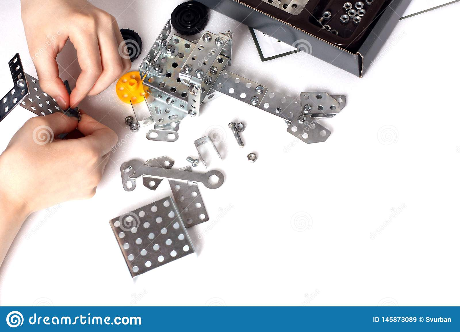 The child collects the metal parts of the child model kit