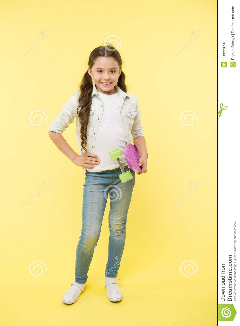 Child cool and confident likes skateboarding. Joyful and happy. Kid girl casual style with penny board enjoy childhood