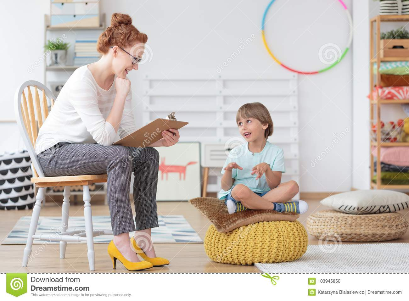 Child counselor during psychotherapy session