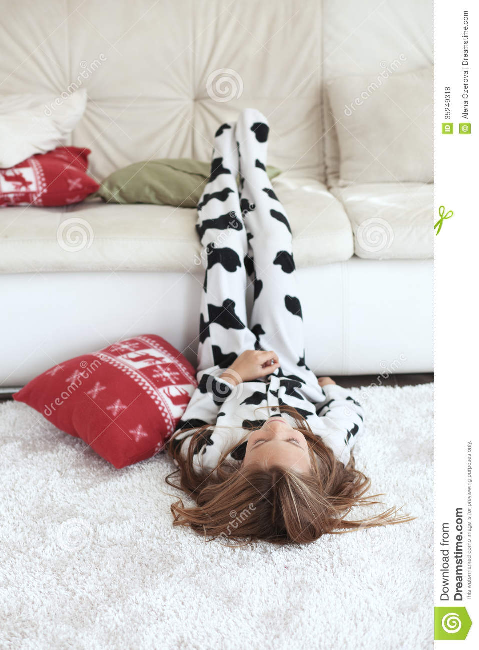 Portrait of child in soft warm cow print pajamas playing at home