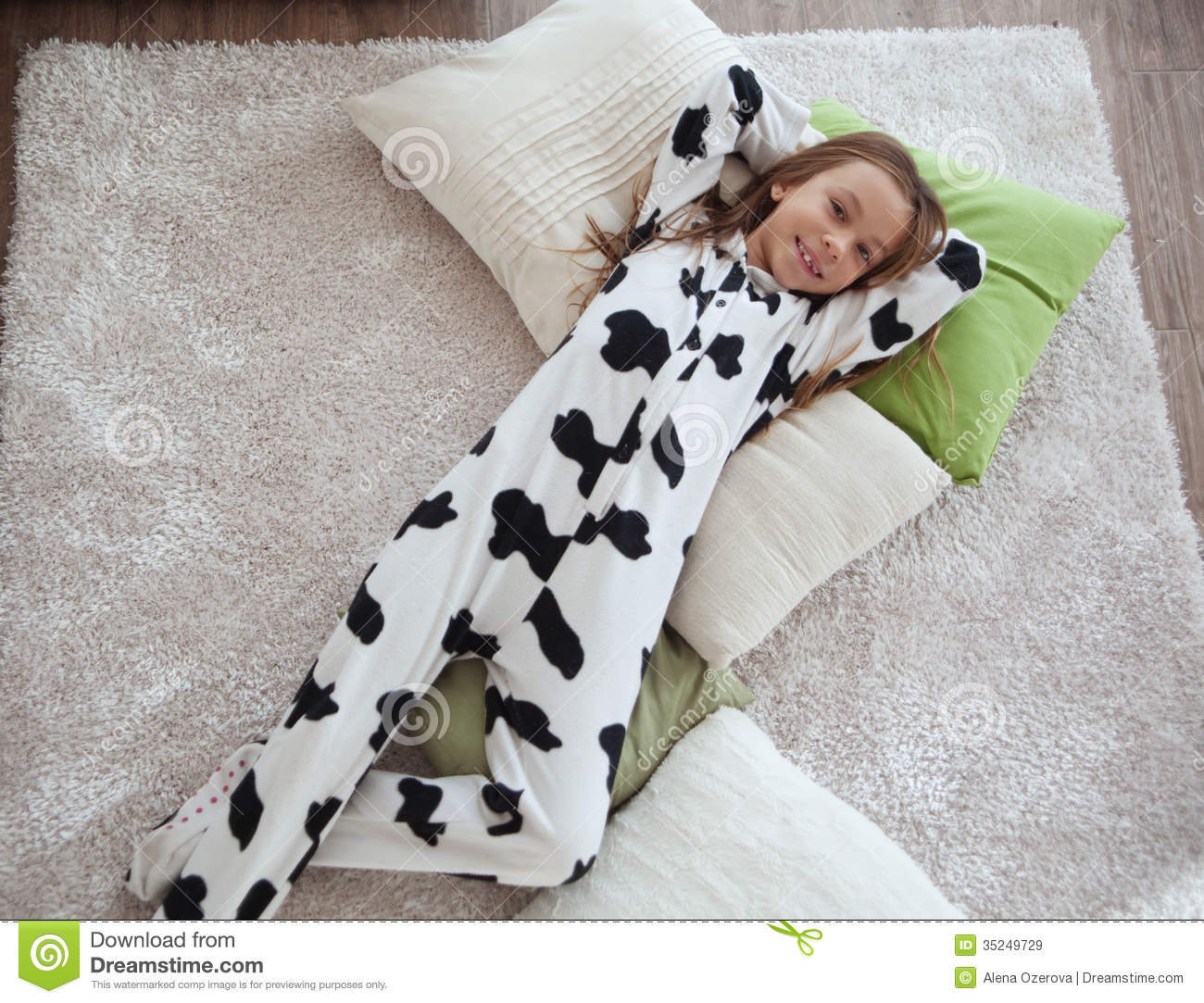 Portrait of child in soft warm cow print pajamas waking up at morning