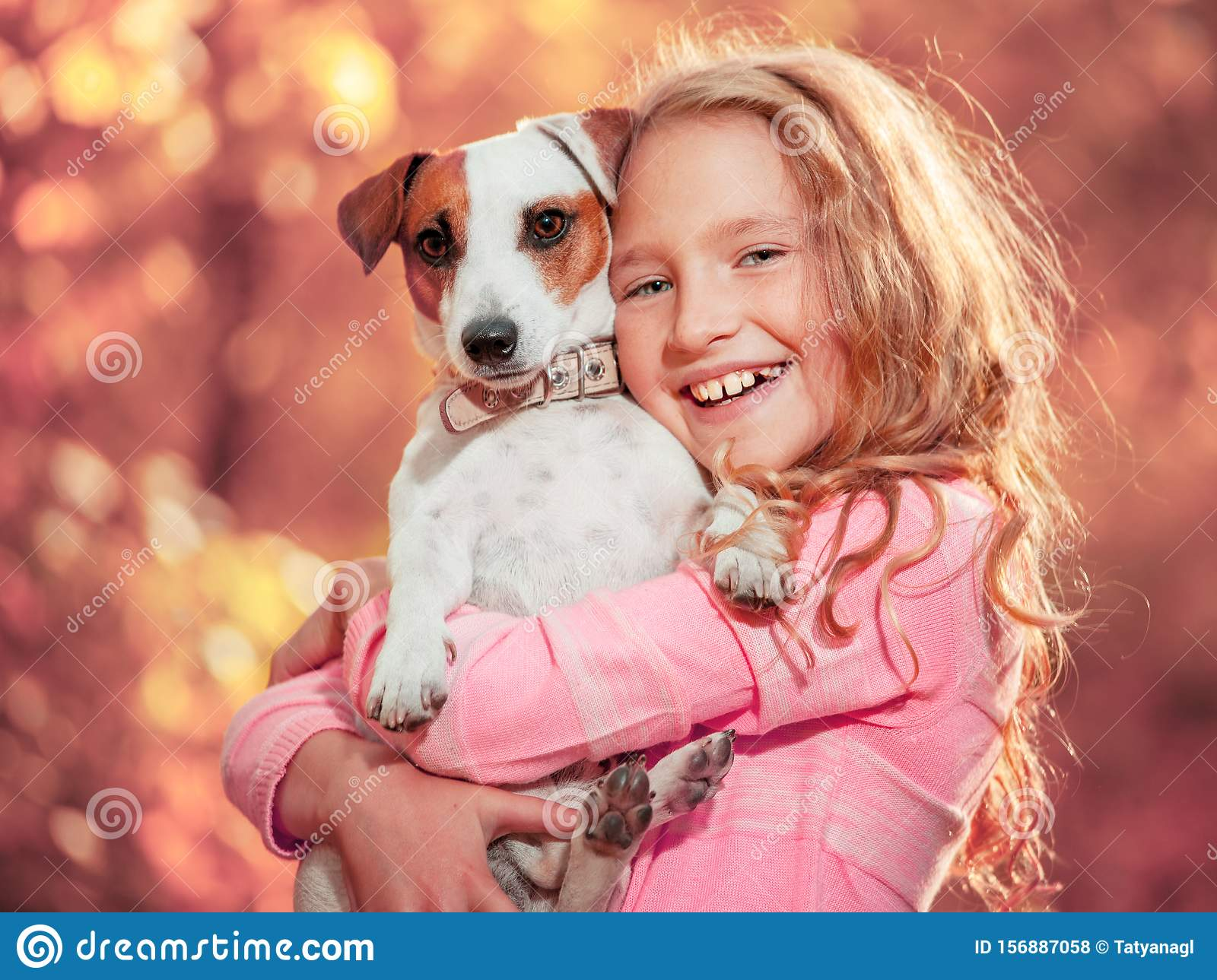 Child with dog at autumn