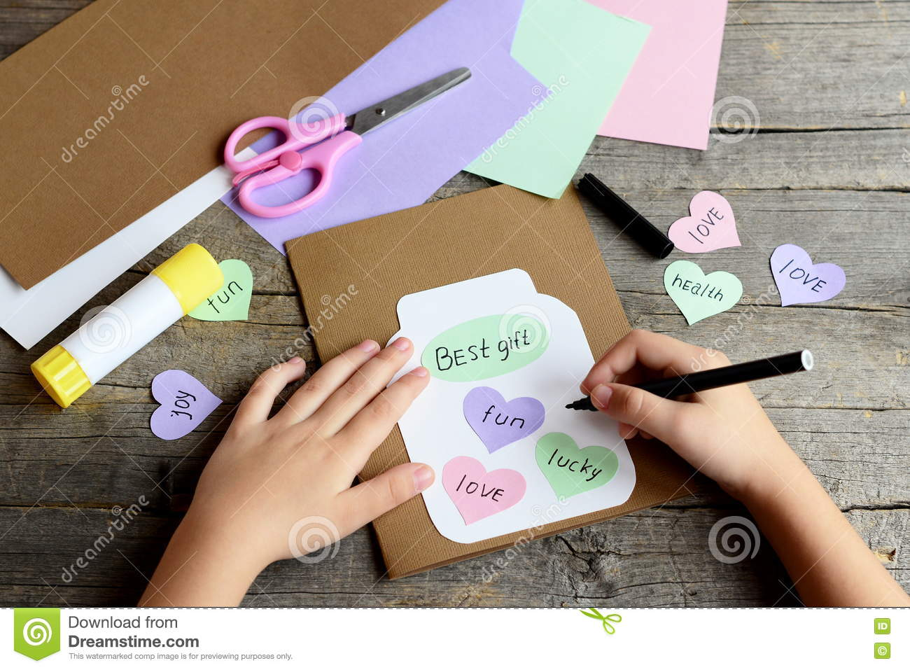 Child Doing A Birthday Card Child Holds A Black Marker In Hand And