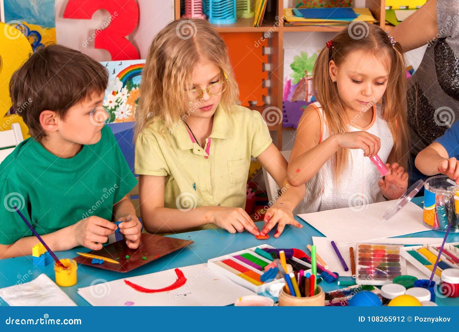 Child dough play in school. Plasticine for children.