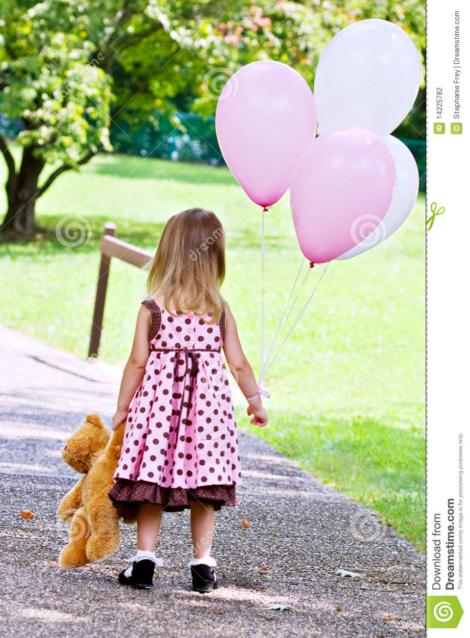 Dragging Teddy Bear And Holding Balloons Stock