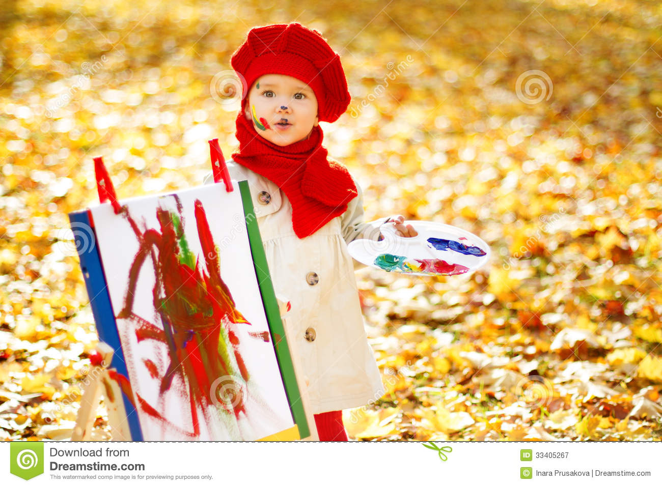 ... : Child drawing on easel in Autumn Park. Creative kids development
