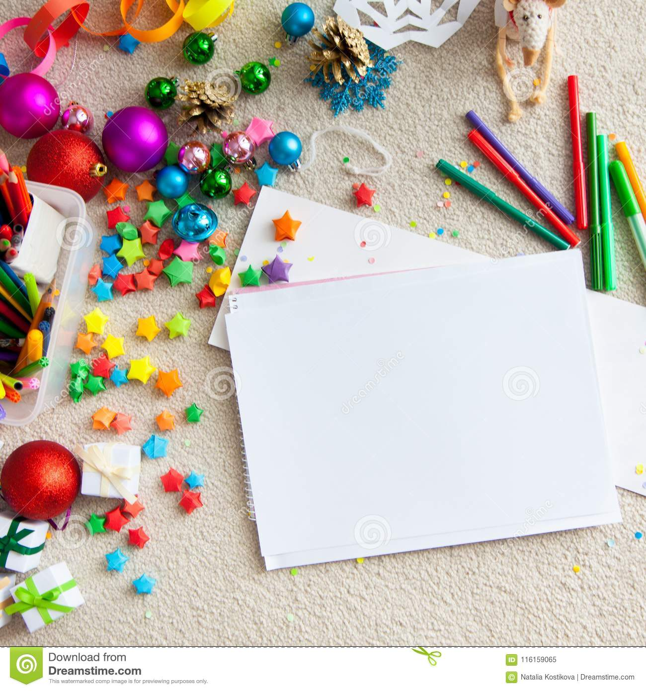 a boy draws a christmas tree childs drawing christmas the child lies on the floor and draws in a notebook with white paper - Office Supply Christmas Decorations