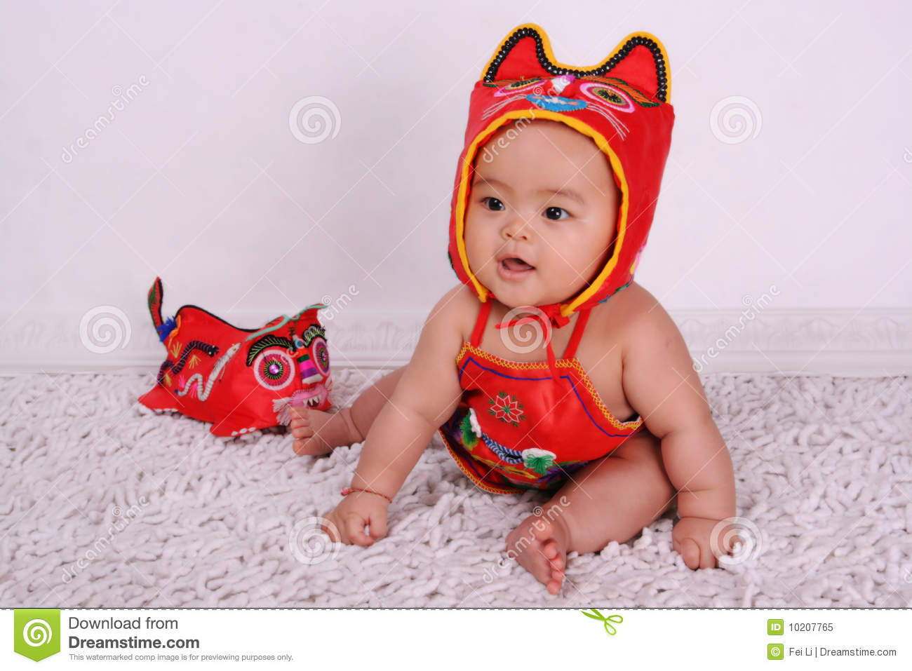 A Child Dressed In National Costumes Of China Royalty Free ...