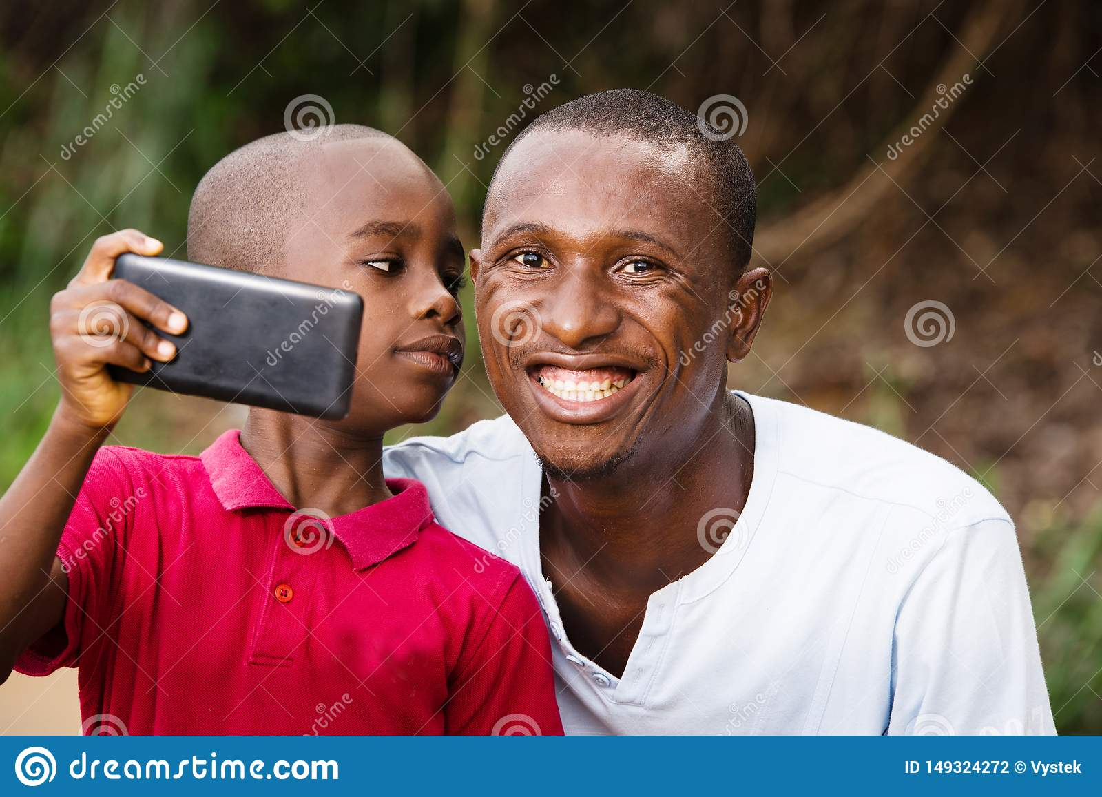 Close-up of a man and his child, happy