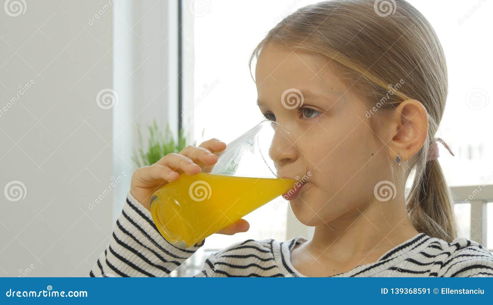 Child Drinking Orange Juice, Kid at Breakfast in Kitchen, Girl Lemon Fresh