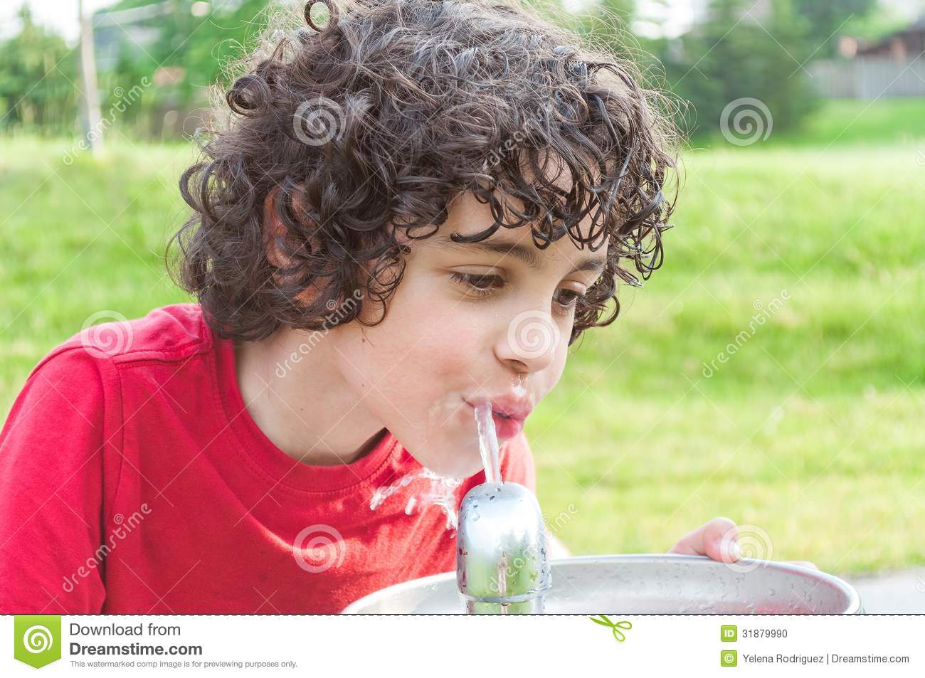 Child Drinking From A Water Fountain In A Park Stock Photo - Image ...