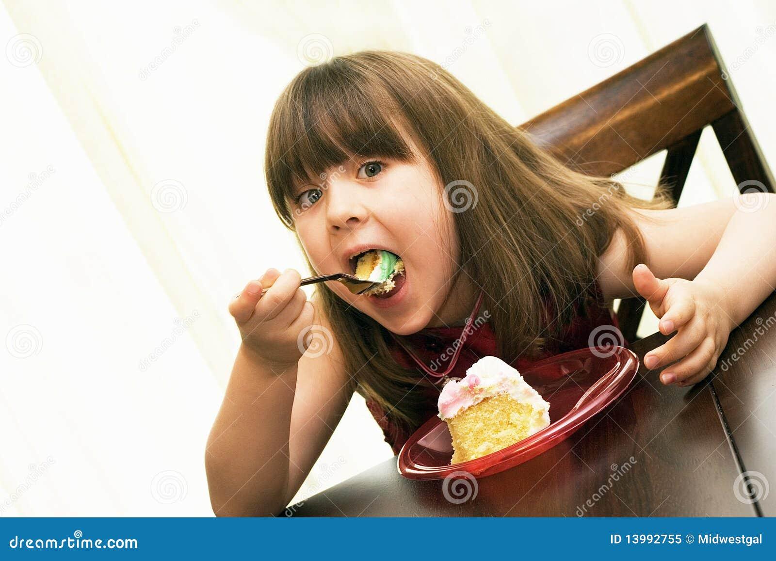 Child eating birthday