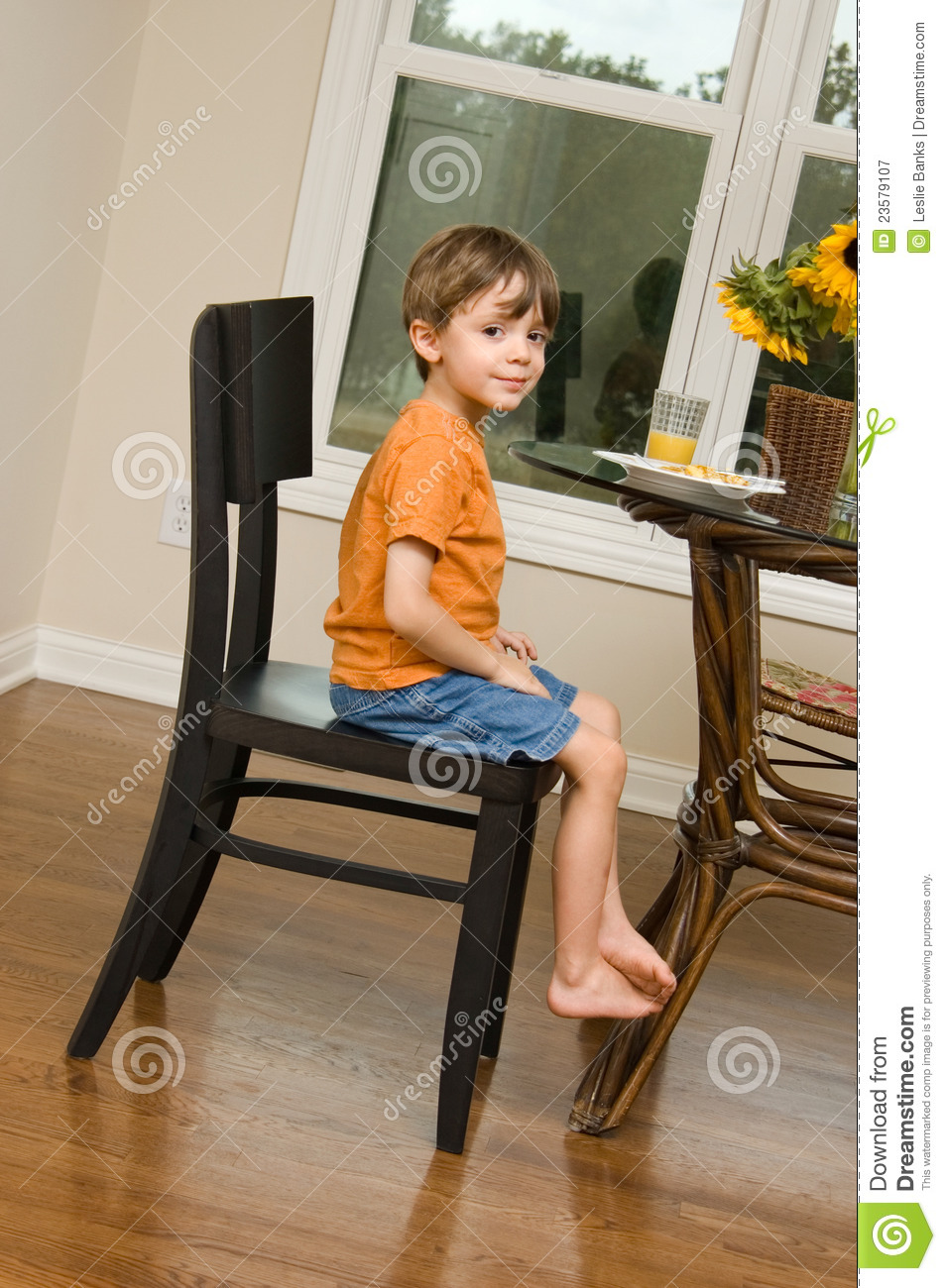 Picture Kid Sitting At Table
