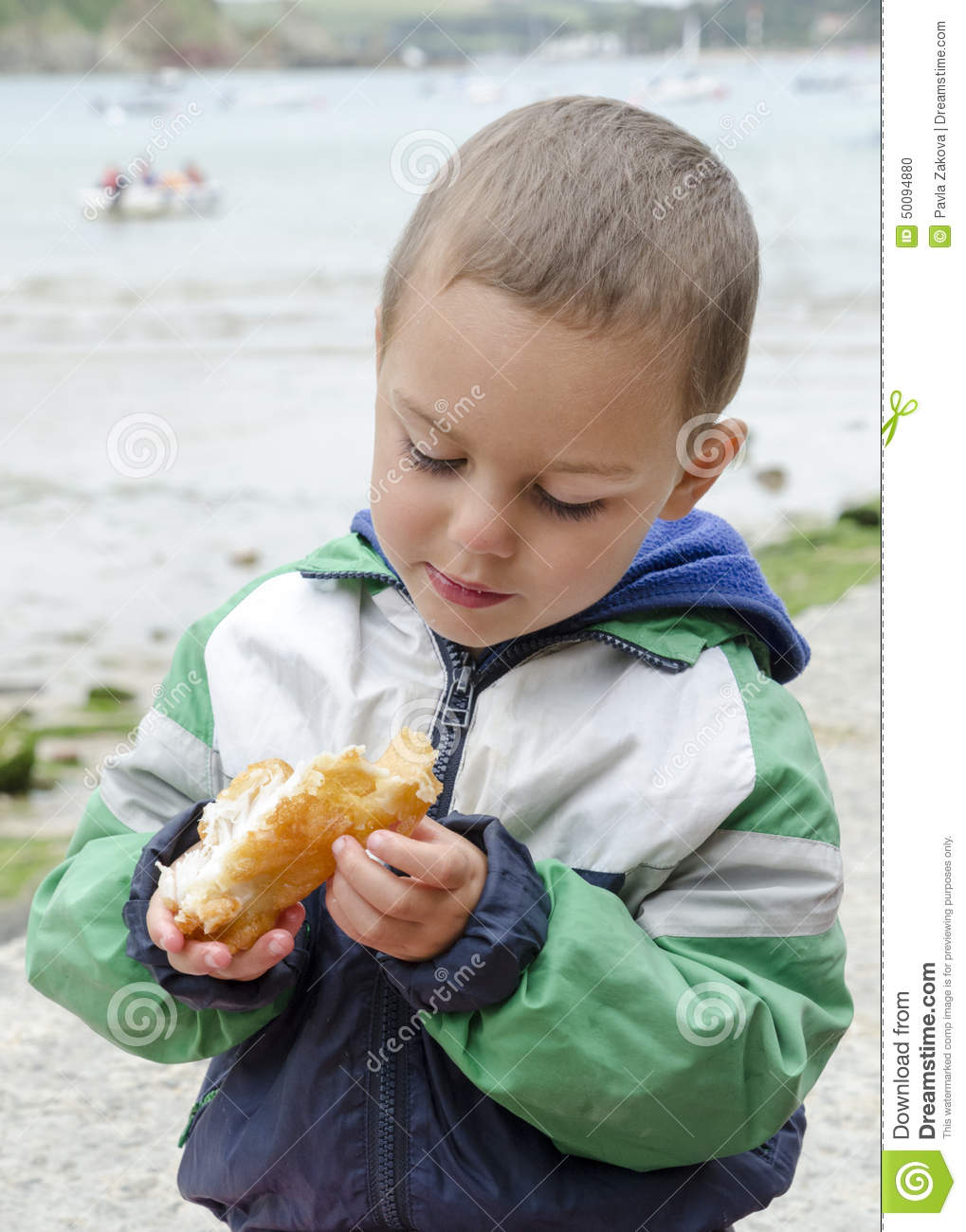 Child eating fish outdoors stock photo image 50094880 for Dreaming of eating fish