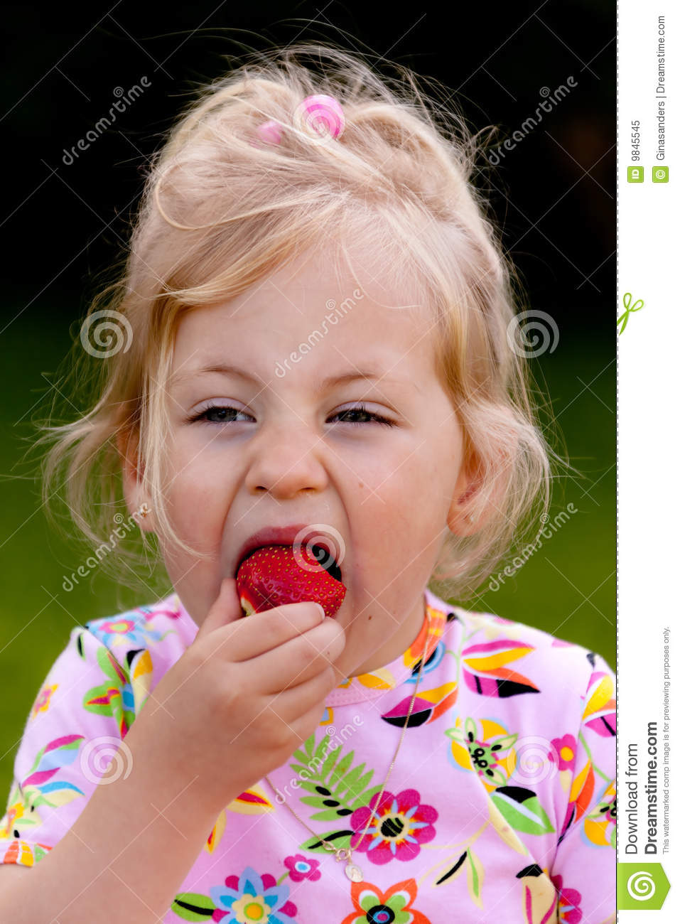 Child Eating A Strawberry In The Garden Royalty Free Stock