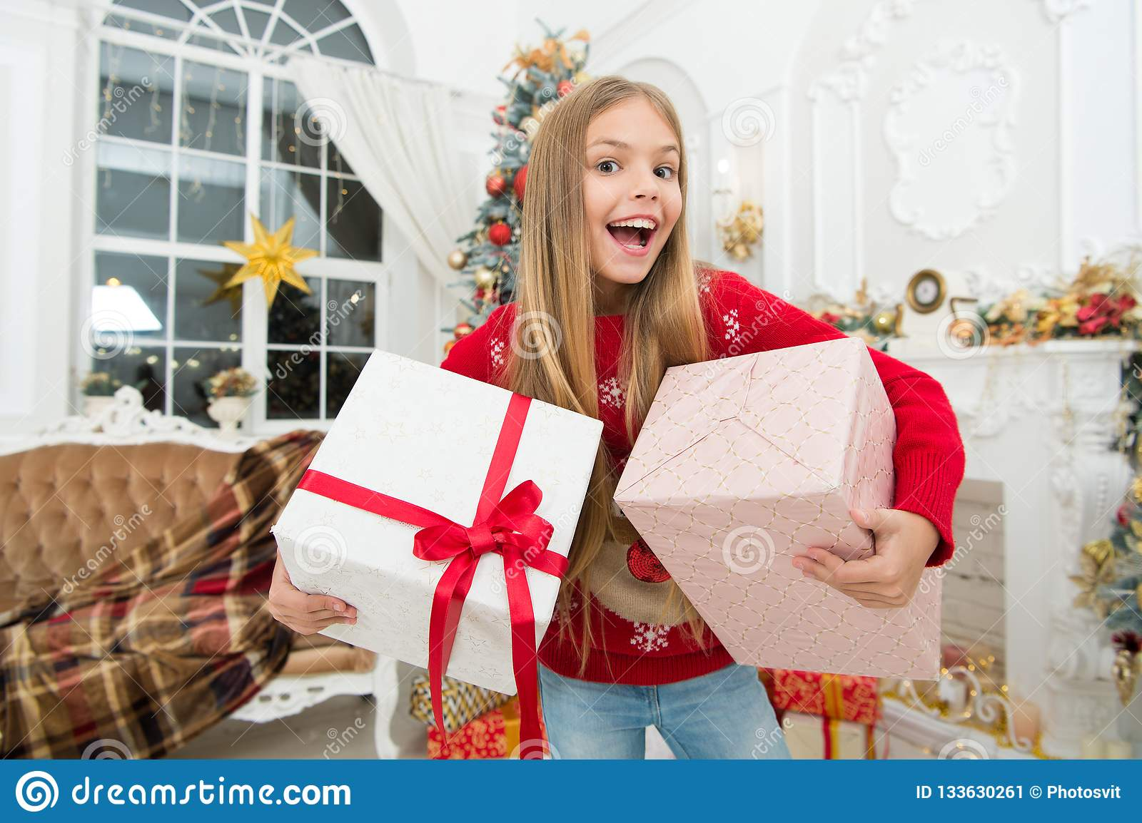 Child enjoy the holiday. Christmas tree and presents. Happy new year. The whole world in one touch. Winter. xmas online