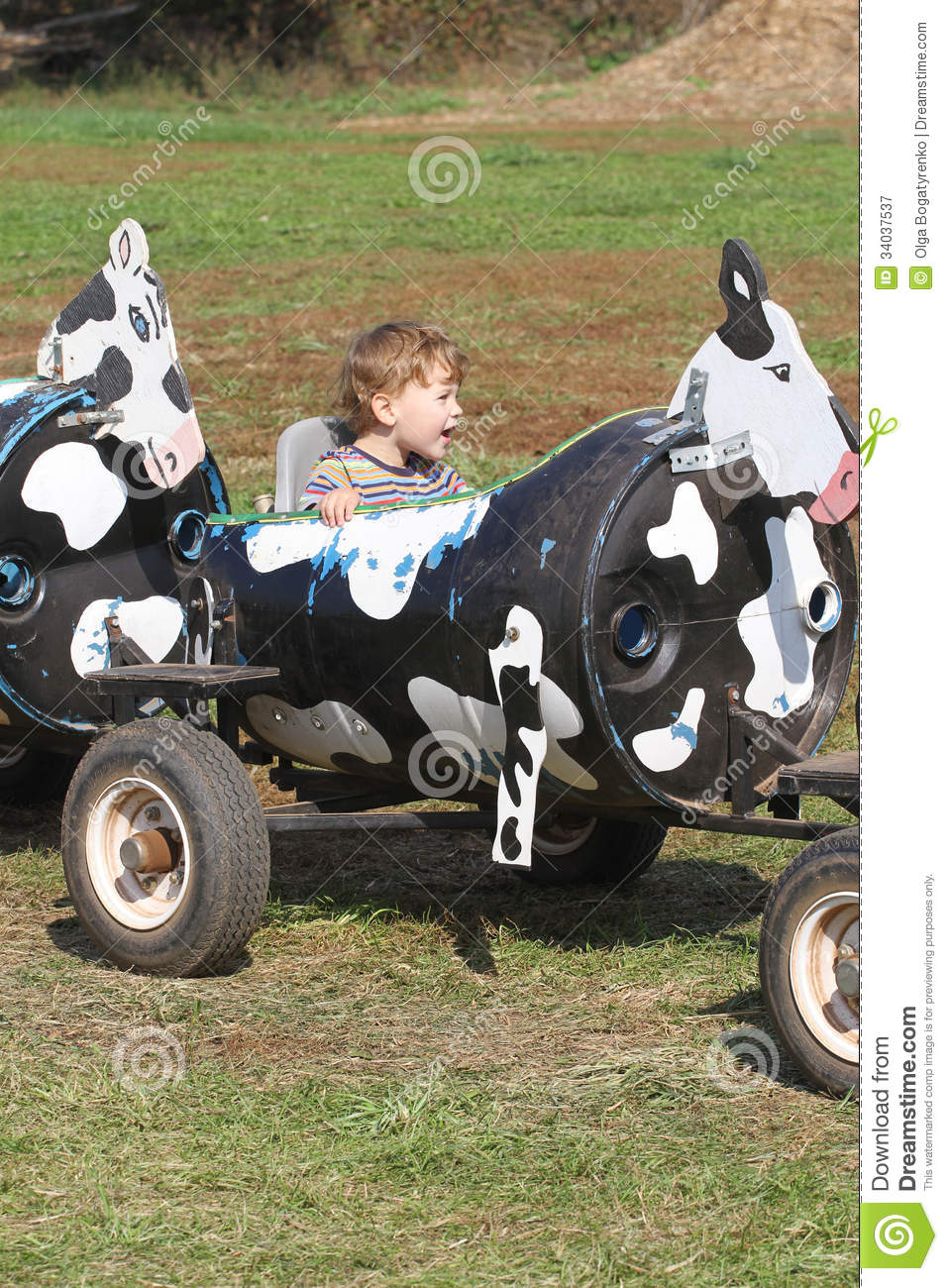 Child on a farm ride hayride