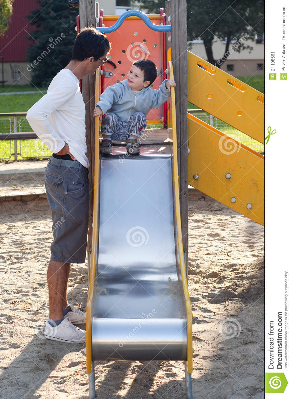 Child and father at playground