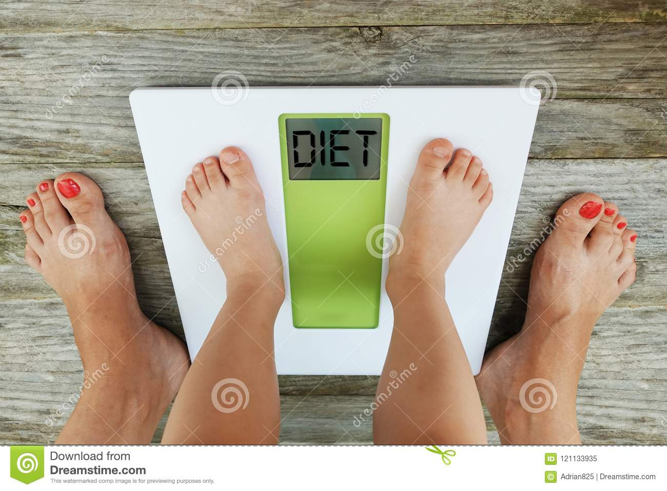 Child feet standing on digital weight scale in front of his mother, diet recommendation