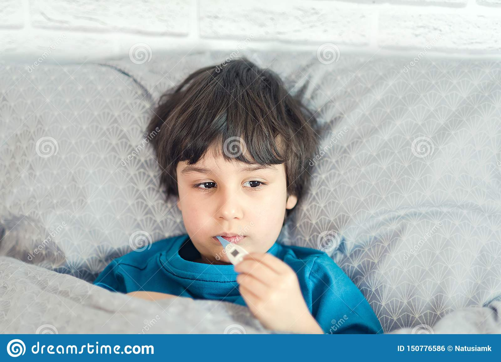 Child flu sick, boy with medical thermometer in mouth, health illness. Kid with cold rhinitis, get cold
