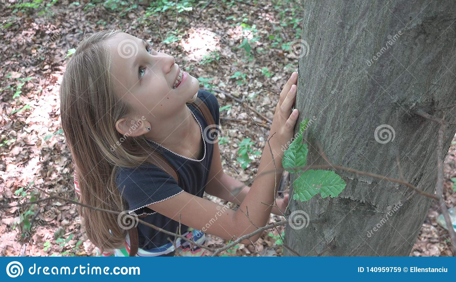 Child in Forest, Kid Playing in Nature, Girl in Adventure Outdoor Behind a Tree