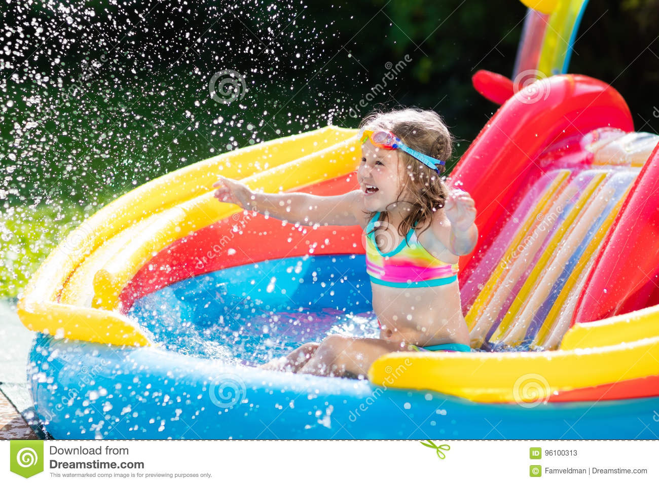 Download Child In Garden Swimming Pool With Slide Stock Image