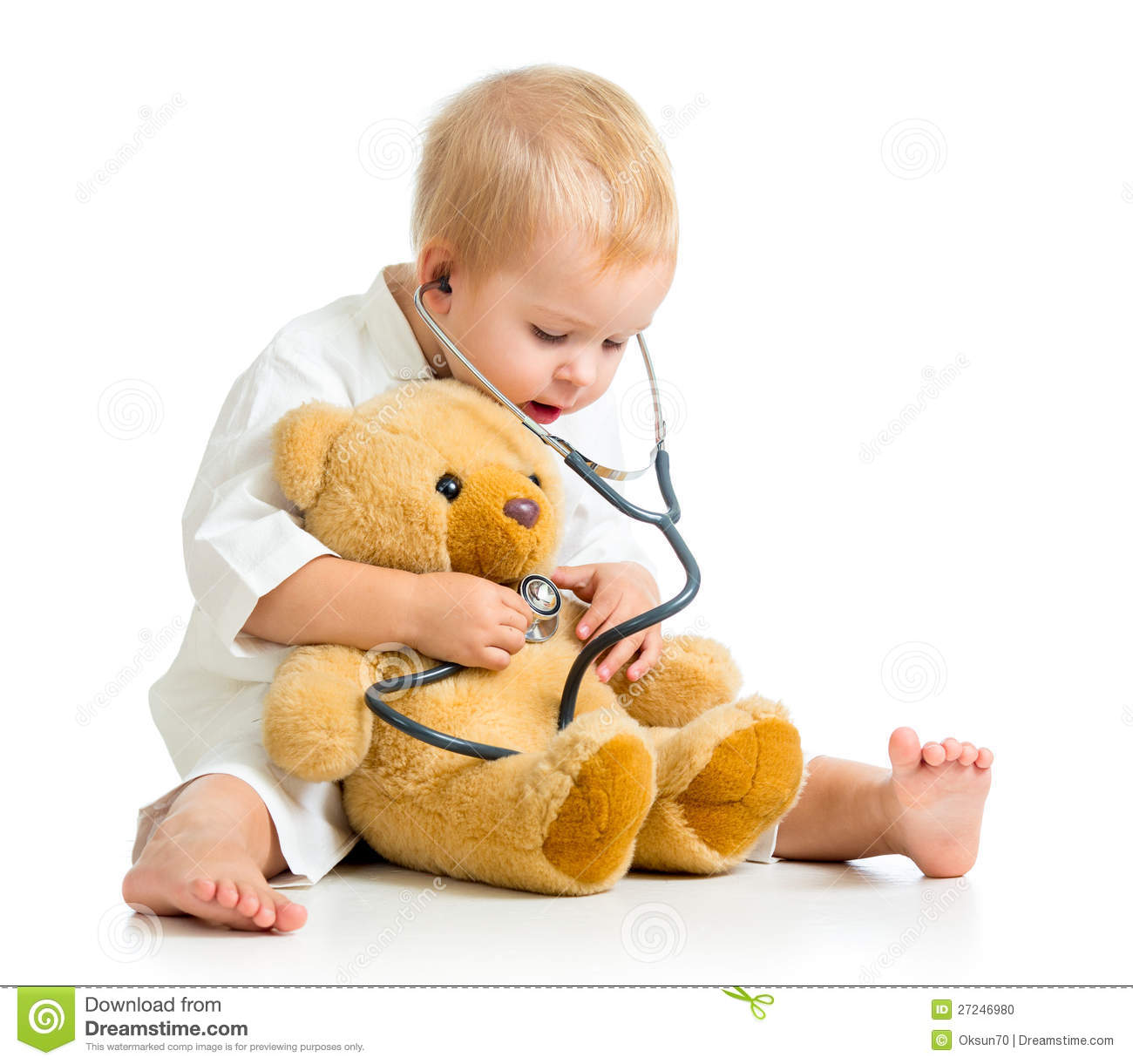 Child girl with clothes of doctor and teddy bear