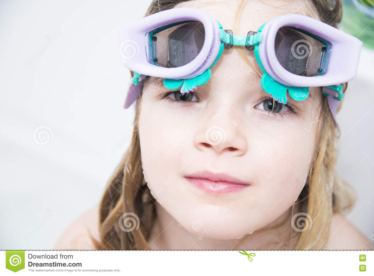 Child girl with diving goggles dive in the bathtub