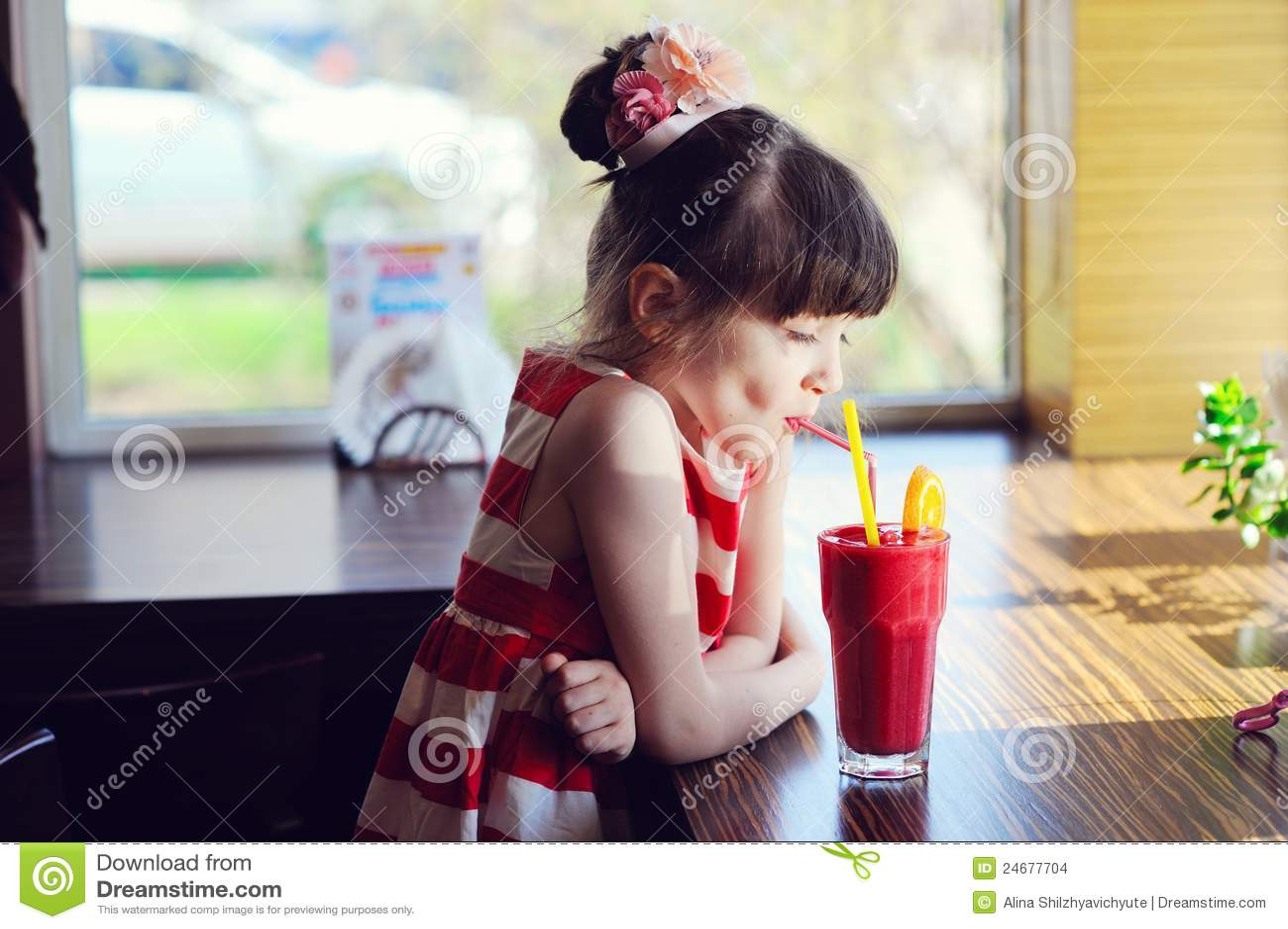 Child Girl Drinking Strawberry Smoothie Stock Photo