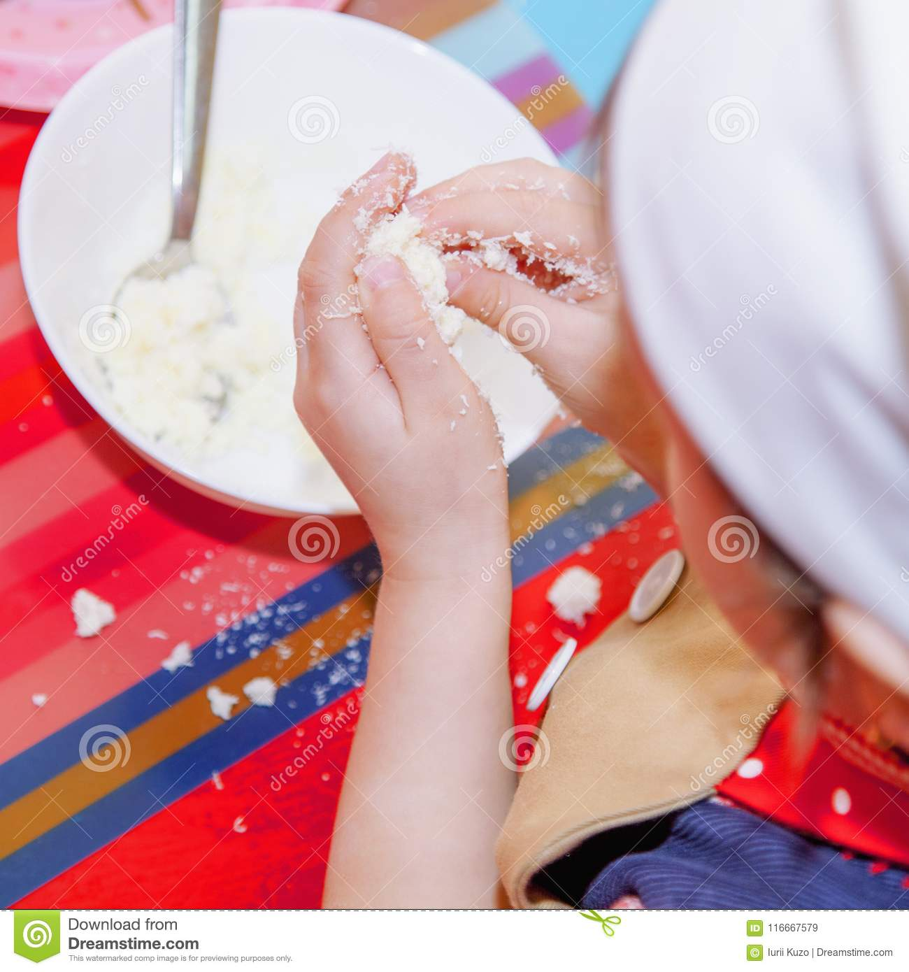 Child Girl Is Learning How To Make A Cake Humorous Photo Selective Focus On