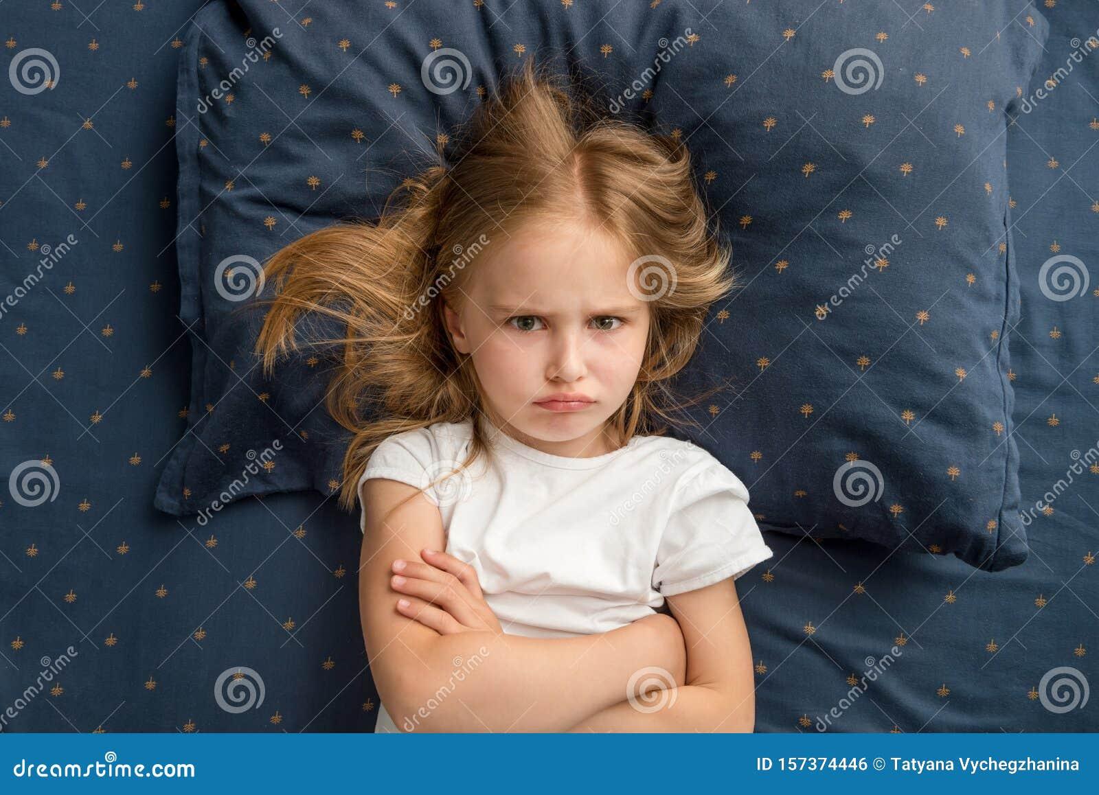 Child Girl Lying On The Bed Refuses To Sleep Stock Photo ...