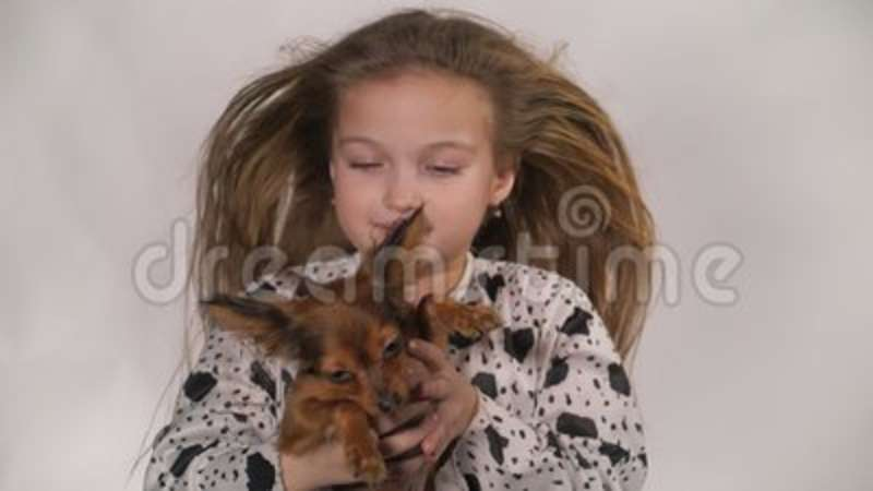 Girl blowing both a dog
