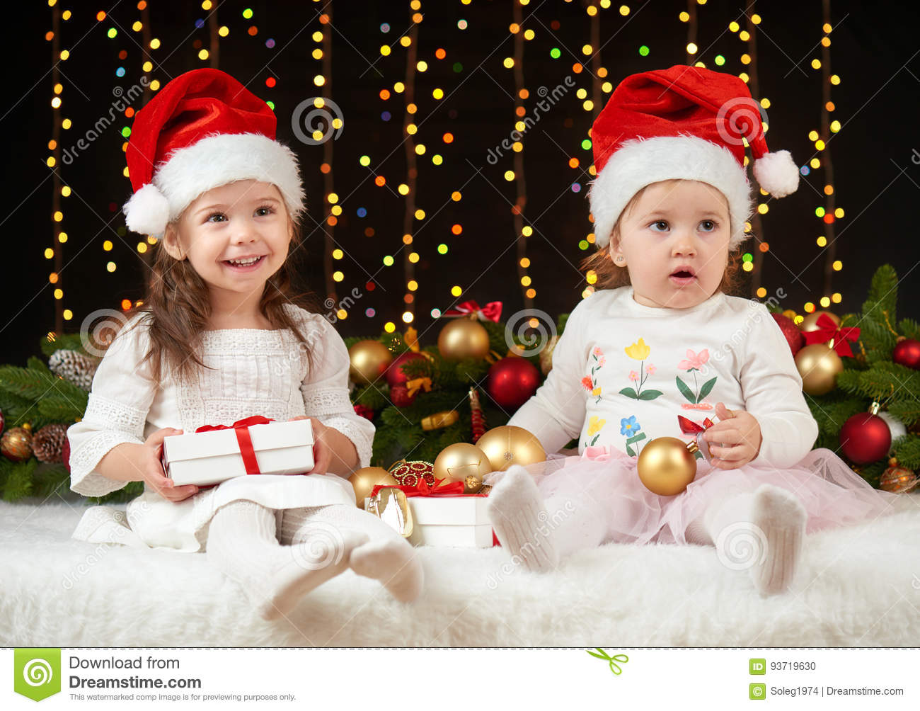 Child girl portrait in christmas decoration, happy emotions, winter holiday concept, dark background with illumination and boke li