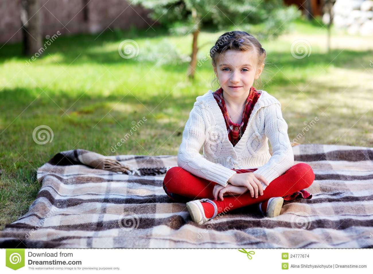 Child Girl Sitting On Plaid In A Garden Stock Images