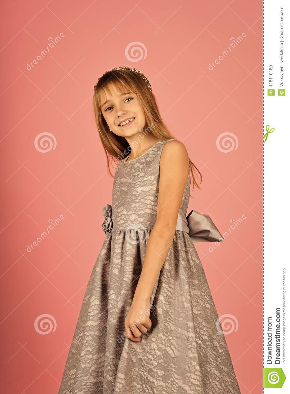 d4b0a3cdd443 Little girl face portrait in your advertisnent. Child girl in stylish  glamour dress, elegance. Look, hairdresser, makeup. Fashion model on pink  background, ...