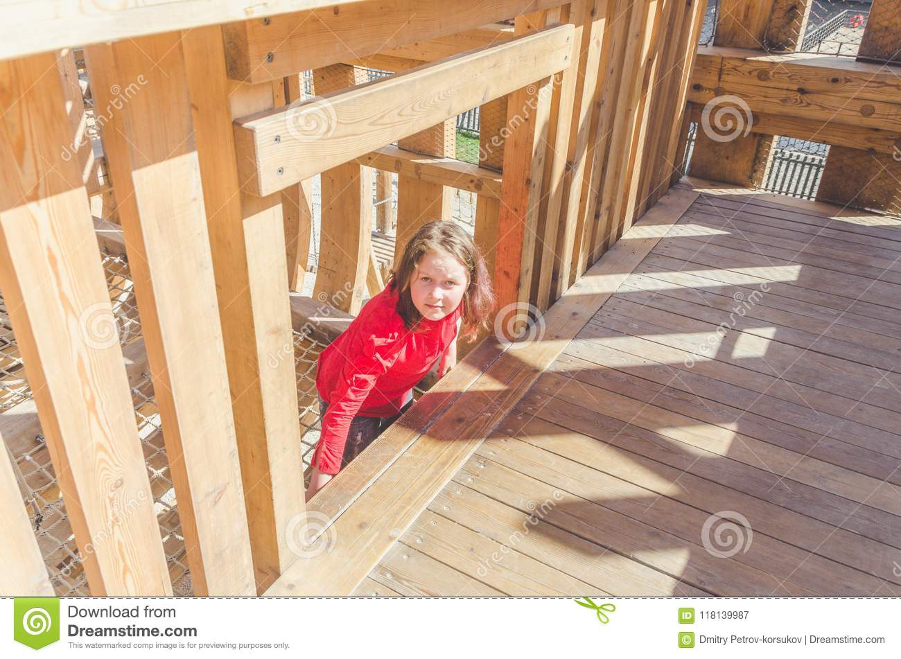 Girl On A Wooden Playground In The Form Of A Pirate Ship Stock Image