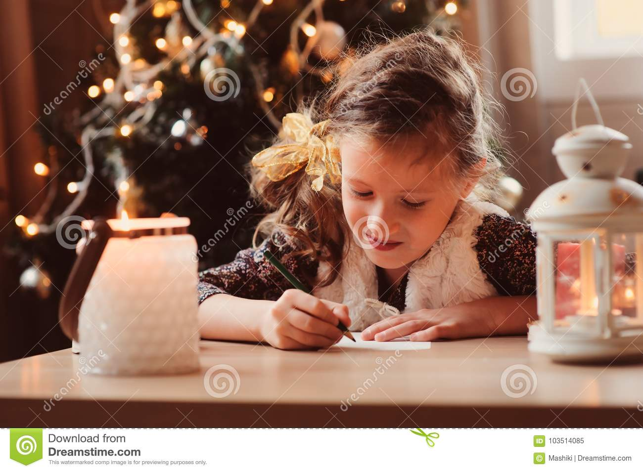 Child Girl Writing Letter To Santa At Home. 8 Years Old Girl Making ...