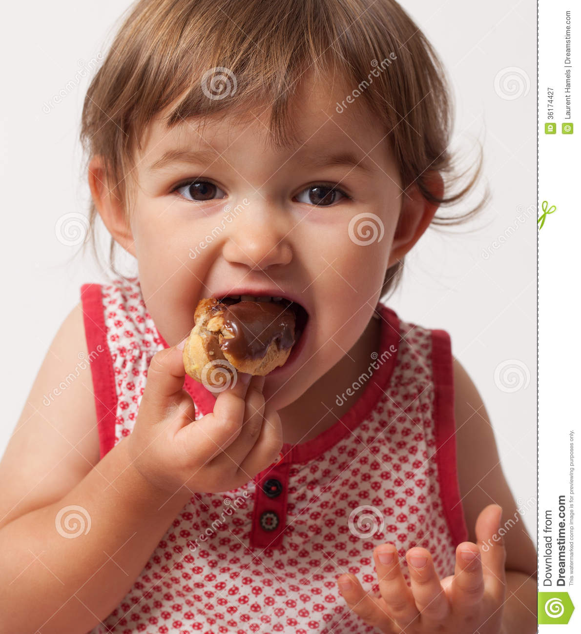 Child Gluttony For Chocolate Food Royalty Free Stock