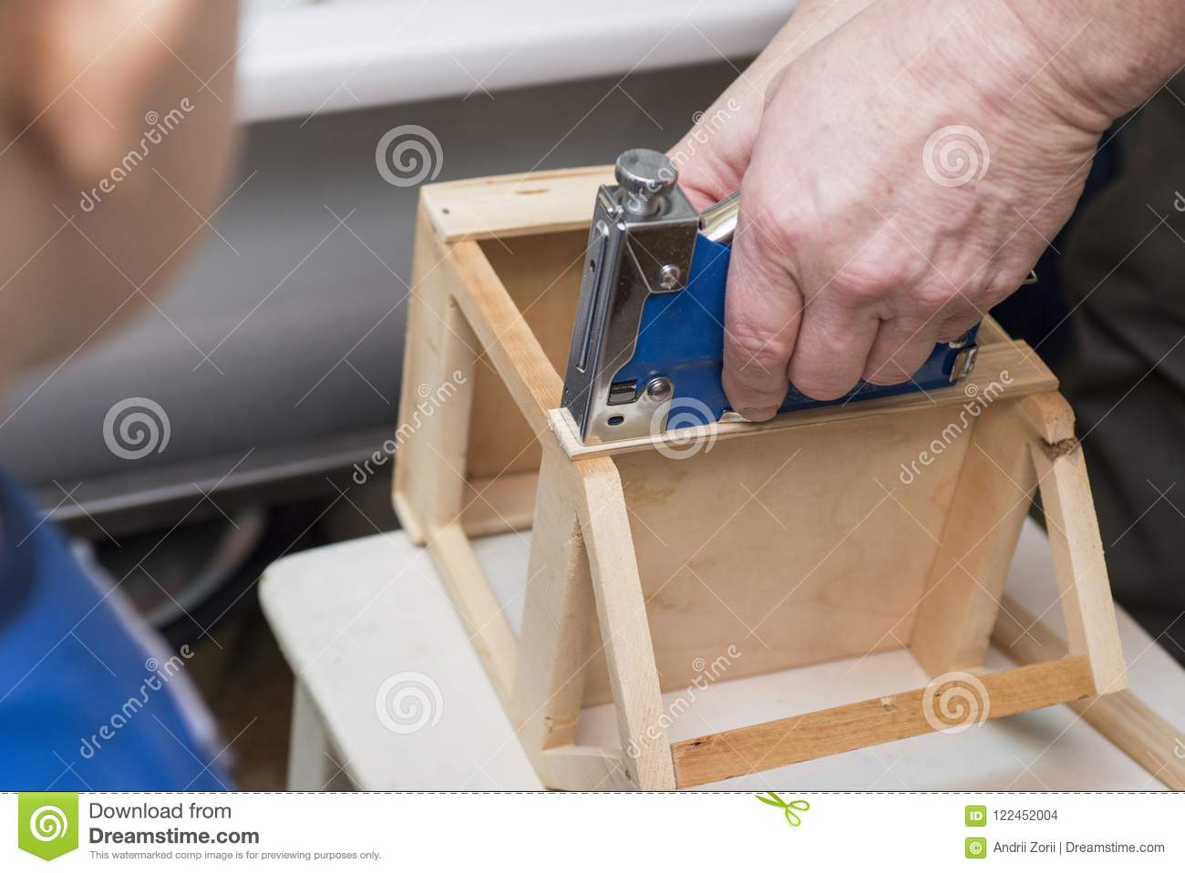 child and the grandfather or the father together make a birdhouse rh dreamstime com make a birdhouse with seeds make a birdhouse with seeds