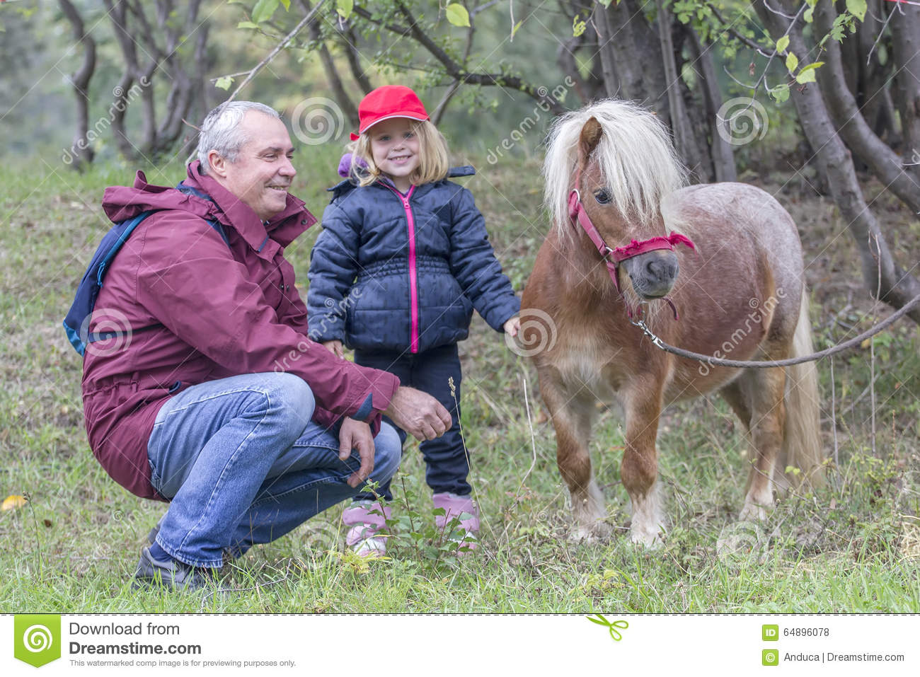 Child, grandfather and pony