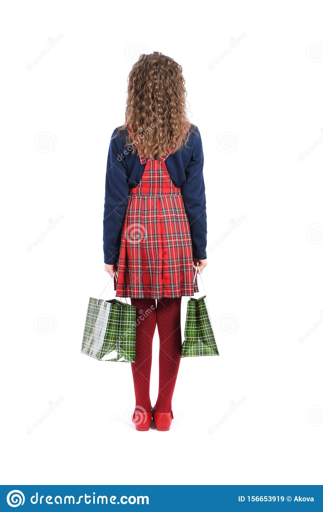 Child with a green packaging checkered texture isolated on white background. Girl likes shopping on sale season. Holiday present,
