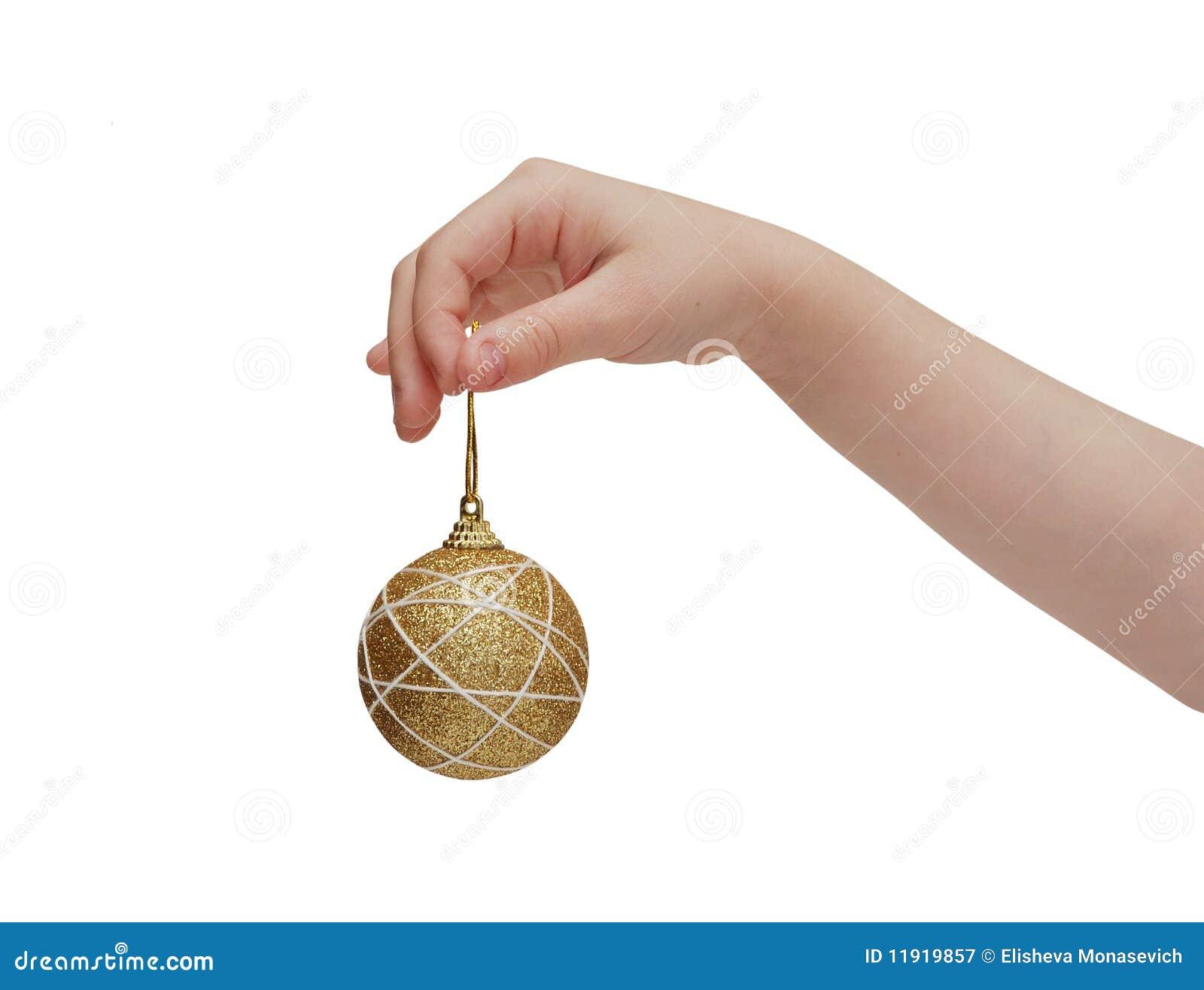 Child Hand Holding Golden Christmas Ball Royalty Free Stock ...