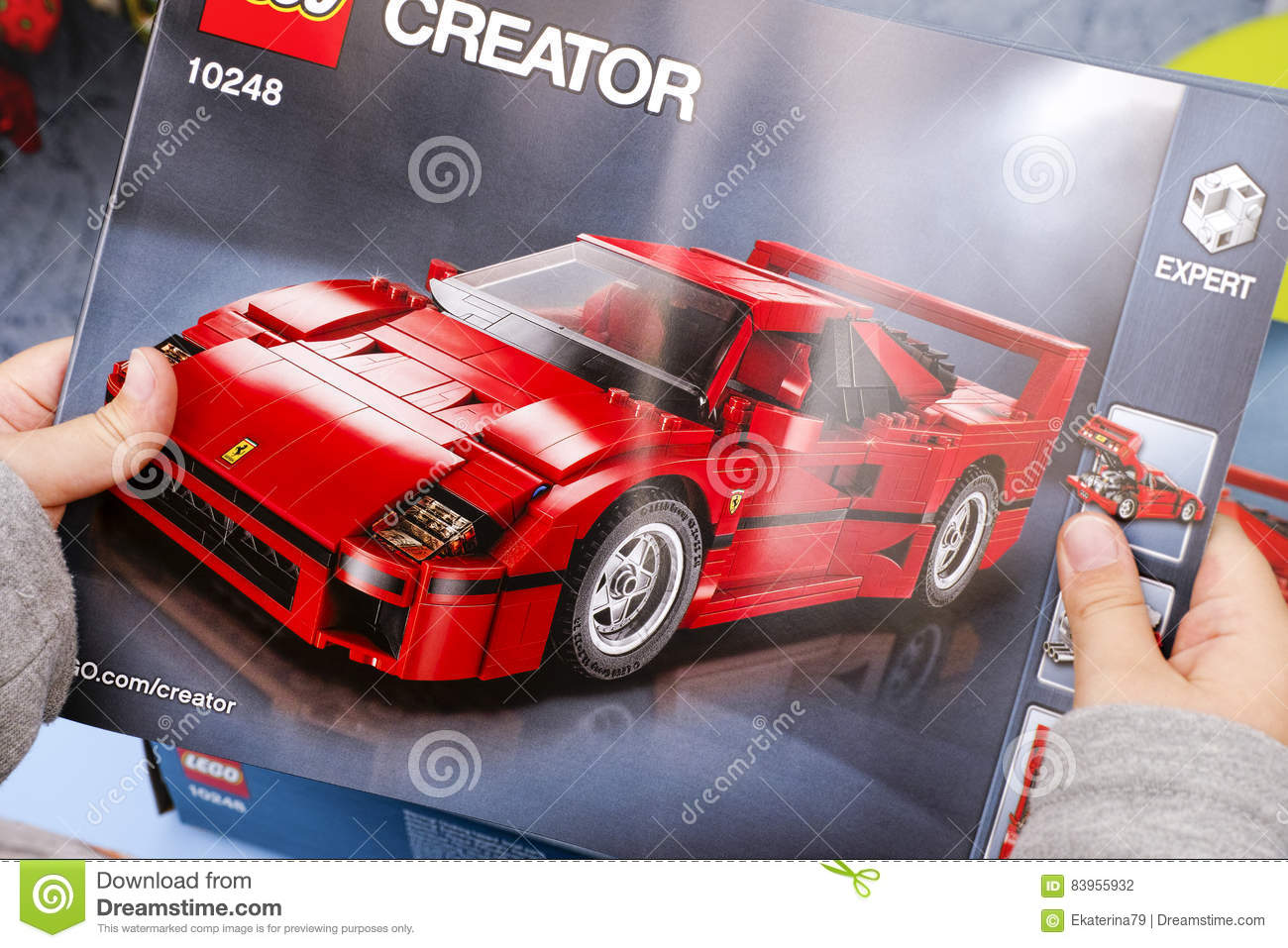Child Hands With Lego Instruction Of Set 10248 Ferrari F40 Editorial