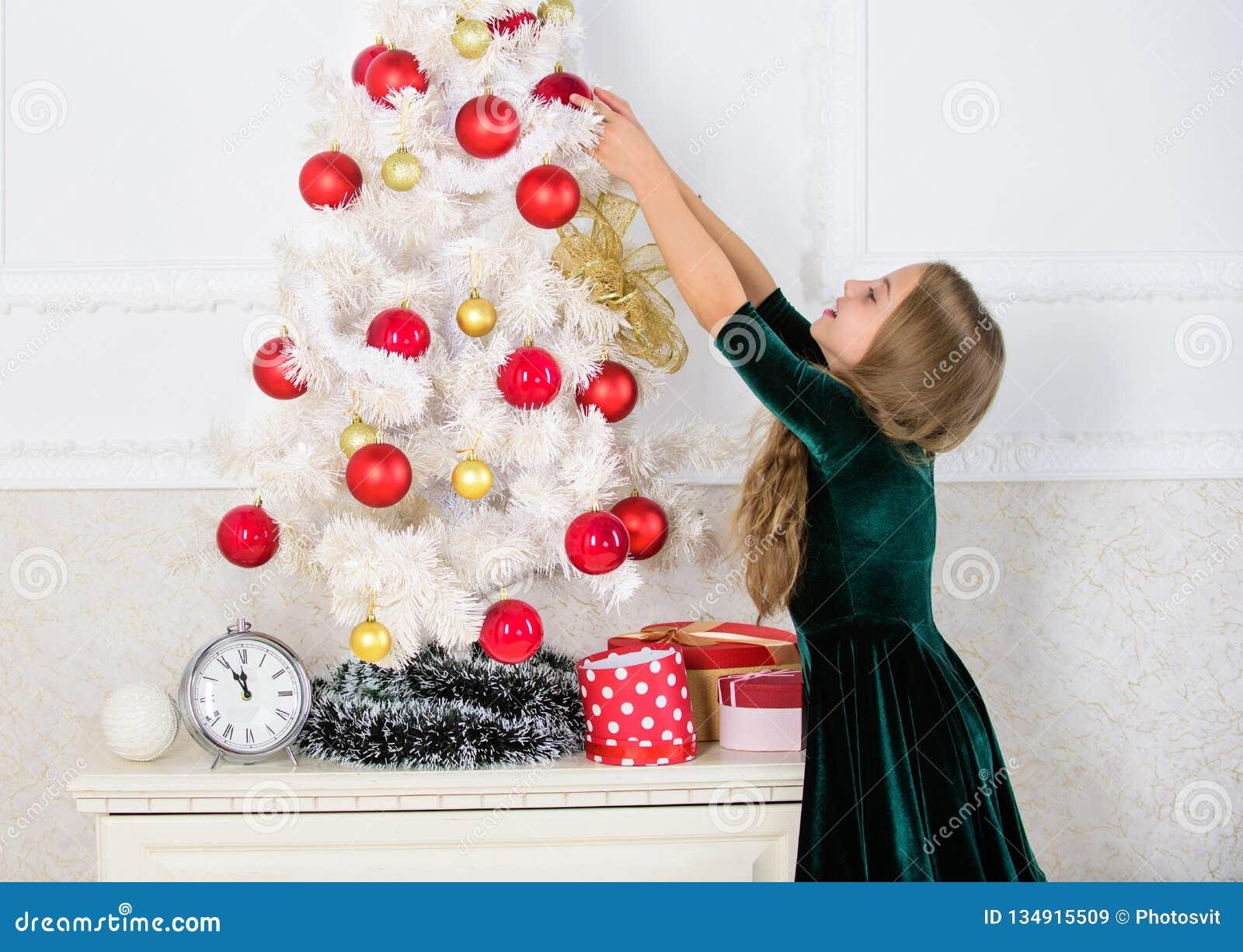 Child Hang Christmas Ornament Ball On Artificial Tree Kids Can